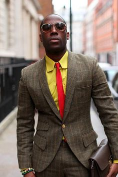 Shop this look on Lookastic: http://lookastic.com/men/looks/yellow-long-sleeve-shirt-red-vertical-striped-tie-brown-wool-suit/9041 — Yellow Long Sleeve Shirt — Red Vertical Striped Tie — Brown Check Wool Suit
