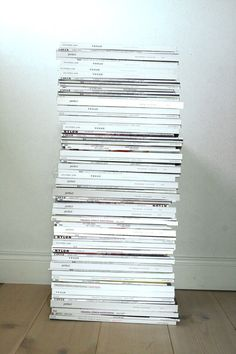 a mile-high stack of Vogue magazines for side table.  #simplyart