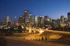 Skyline of Downtown Calgary, with Lions Bridge, at night.