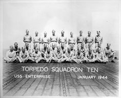 Pilots of Torpedo Squadron (VT) 10 gathered on the flight deck of carrier USS Enterprise (CV-6) in January 1944