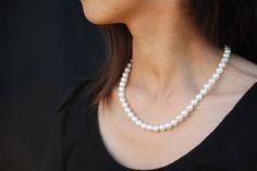 Cost: $1,850.00.   White princess length akoya pearl strand. All natural. No dyes.  http://masatopearls.com/collections/strands/products/true-white-princess-strand-7-7-5mm