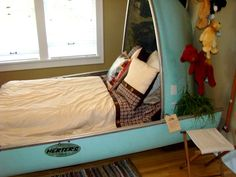 camping-themed bedding | The room was done with a camping theme~ take a look at the desk setup ...