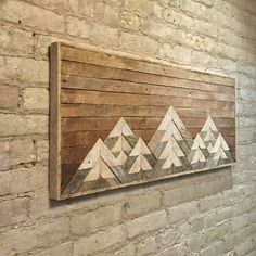 This one of a kind wall art is made from reclaimed lath wood. The finish is left completely natural to give it rustic character and interest.
