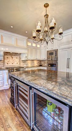 Beautiful use of granite in the kitchen! The little beverage fridge in the island, awesome idea!