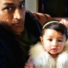 Our children's first birthdays are forever etched in our memories. We can't believe the little darlings with their tiny hands and feet are already one! Ditto for Indian Cricket Captain MS Dhoni whose little daughter Ziva just turned one on Feb 6. But what we are going bonkers over is just how dashing the father daughter duo look together!