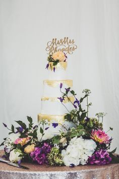 Gold Leaf Wedding Cake with Personalised Cake Topper | Memoir Suzanne Neville Wedding Dress | Marquee Reception | Claire Penn Photography | http://www.rockmywedding.co.uk/jessica-ilka/