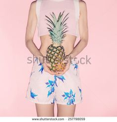 Tropical Girl holding Pineapple. Fashionable Vanilla Summer style - stock photo