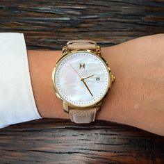 The mother of pearl face is so unique! I love mother of pearl almost as much as I love rose gold and this has both. Plus brown leather so that's amazing