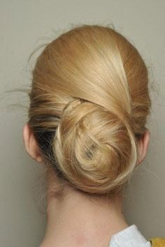 Here's the thing: It looks as if it starts as a traditional sock bun, then two thin layers of hair from the front are wrapped around the bun from opposite directions. And it's a little messy and lived in, just like I like it. Oh-so-simple, but so chic.