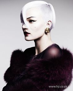 2012 shaved side hair hairstyle    A blonde bob with an undercut section was prepped with smoothing cr�me and blow-dried using a Denman brush to achieve a sleek, head-hugging shape.     Hairstyle by: Akin Konizi  Hairstyle picture by: Jenny Hands  Salon: hob salons  Location: London