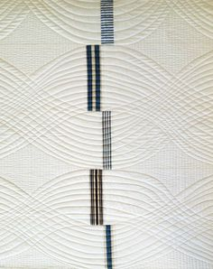 Walking foot quilting. Draw the first two wavy lines of the cable and use as guides.