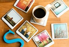 Polaroid coasters. Include pictures with meaning - office locations across the world, customers in target demographic engaging with product, bright colors.    Think of interesting storage mechanism that is subtle but still allows coasters to be on display (i.e. glass case?).