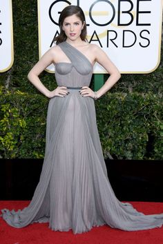 Trolls Star, Anna Kendrick, wore a chic gray one-shouldered dress with multiple earrings and stackable bracelets.