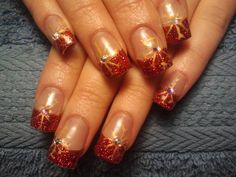 Christmas  Red glitter acrylic nails with gold painted  snowflakes and swarovski crystals