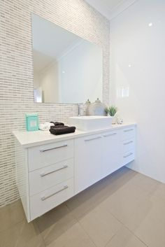 Vanity - tile wall, floating vanity, and chrome