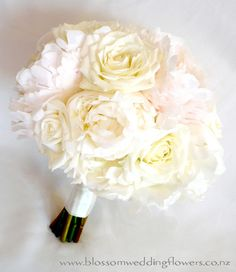 Ivory rose and peony bouquet. I want something like this for mine but with little purple flowers here and there to make it stand out :)