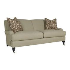 Like the legs and neutral color.  Would be fun to do fun pillows in different colors and patterns.