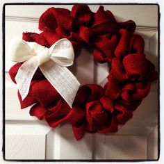 red burlap christmas wreath add a couple small christmas ornaments too white and red bow for our red door
