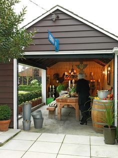 Entertainers take note. If you have a detached garage in the rear of your house, this serves as a unique opportunity to create an intimate dining experience. Open walls and sliding doors keep you protected from the elements. Outdoor Sheds, Outdoor Rooms, Outdoor Dining, Indoor Outdoor, Outdoor Decor, Outdoor Pavilion, Outdoor Gardens, Garage Renovation, Garage Remodel