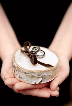 Brides.com: . For a ring pillow, we sanded a piece of birch and drilled a hole for ribbon, which was looped through the bottom.  Rings, Fantasy Jewelry Box. Ribbon, Midori.