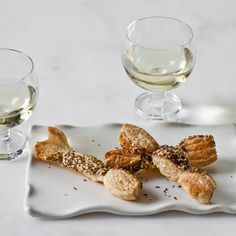 """Inspired by the """"everything"""" bagel, Melissa Rubel Jacobson coats buttery puff pastry twists in a mixture of seeds and spices.  Cocktail Party Re..."""
