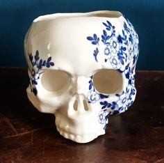 Measuring 12cm high and 15cm from front to back this skull has been handmade from translucent porcelain. It functions as a tea light  holder or planter (it has three small holes in the top to convert it to a hanging planter). Please be candle safe when using this item, it will become hot to the touch if used as a candle holder.