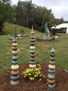 Three large totems on display in a sculpture garden at Mt. Sunapee, NH