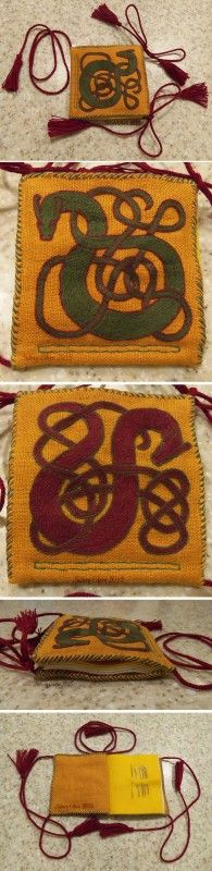 Great Wyrm Needle Book, by Sidney Eileen, Stem stitch in DMC cotton floss on linen, hand stitched with linen thread, edged with modified fishbone stitch, wool felt pages, and cotton lucet braid ties with cotton tassels.