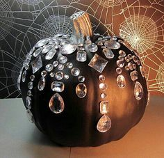 Black BeaDazzled Pumpkin: I love sparkly things, and I love pumpkins. Totally making a few of these this year. #budgettravel #travel #halloween #DIY www.budgettravel.com