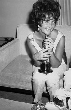 """3/12/14 12:29p The  33rd Academy Awards 1961: Elizabeth Taylor  Holding """"The Oscar"""" and  Dressed very casually  after the Awards Presentation."""