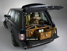 Holland & Holland Range Rover by Overfinch. Perfect for the gentleman farmer, this is a Range Rover with a few essential extras for anyone off out hunting.