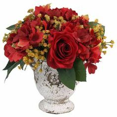 "Arranged in a cracked white pot, this faux hydrangea and rose arrangement accents your decor with rustic-chic style.  Product: Faux floral arrangementConstruction Material: Silk, plastic and ceramicColor: Red, yellow and whiteDimensions: 10"" H x 11.5"" Diameter"
