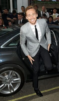 Tom Hiddleston. Because who else would look this good stepping out of a car?