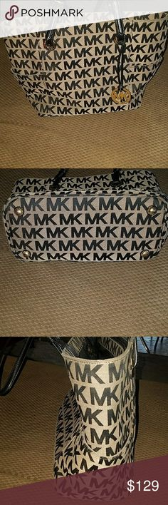 Michael Kors tote medium. Excellent condition! Super cute, gently used MK purse. COLOR: Black/Beige/Black/Gold Jacquard fabric /leather trim. Strap drop : double straps - approx 8 inches (are adjustable) MK logo circle (gold) charm. 16W X 11H X 5D. Interior size : Large. Has 2 slip pockets, 1 back interior zip pocket & 1 zippered center divider pocket. Michael Kors Bags Totes