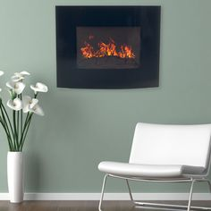 @Overstock - Northwest Black Curved Glass Panel Wall Mounted Electric Fireplace with Remote - Curved black glass surrounds a burning faux wood log that hides the integrated coiled wire heating element. Keep your house or apartment warm during the winter months with unparalleled style.  http://www.overstock.com/Home-Garden/Northwest-Black-Curved-Glass-Panel-Wall-Mounted-Electric-Fireplace-with-Remote/9605549/product.html?CID=214117 $182.99