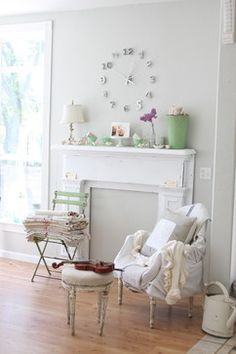 """Add a faux fireplace that doesn't grab all of the attention, a coat of fresh paint will do the trick. In an all-white scheme like this one, the white mantle remains silent, working as a gorgeous pedestal for mementos and collections."" Faux Fireplace Design Ideas, Pictures, Remodel, and Decor"