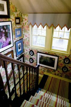 floral walls and the striped runner. love the art covering the walls, including below the window.
