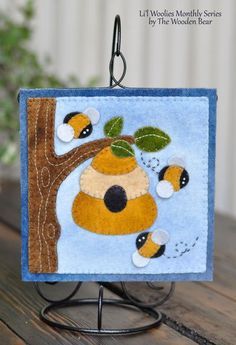 June Beehive- Li'l Woolies Block-of-the-Month Series by The Wooden Bear. Small hanging on a ornament stand. Felt Applique, Applique Patterns, Applique Quilts, Quilt Patterns, Penny Rugs, Small Quilts, Mini Quilts, Felted Wool Crafts, Bee Crafts