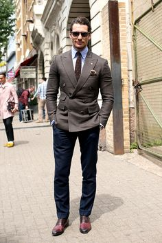 David Gandy - The double breasted jacket/blazer is more versatile and can give you a touch of Italian Sprezzatura, if you have the right attitude, of course. I love the simplicity of this outfit and I believe the dotted tie + sunglasses make the entire outfit. Great way to combine navy with brown and create something unique.