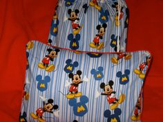 Hey, I found this really awesome Etsy listing at http://www.etsy.com/listing/103364888/mickey-mouse-travel-blanket-4-piece-set