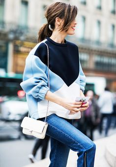 Hanneli Mustaparta wears a colorblocked sweater by Stella McCartney, skinny jeans, and a chain strap bag