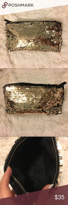Gold Black 2 in 1 Sequin Cosmetic Purse Clutch Bag NWOT Victoria's Secret Gold and Black Sequin Cosmetic Purse Clutch Bag. You can change the color of the bag from gold to black by turning the sequins to show the color you want so it's like 2 for 1!! Super cute bag! Always wanted to carry it as a clutch but I never used it. Zipper closure. Victoria's Secret Bags Cosmetic Bags & Cases