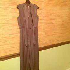 """BCBG silky jumpsuit Elegant mocha colored jumpsuit. Has been altered. Inseam is 30"""". Torso has been taken up . Definitely for a smaller stature person. Sean on leg hem is coming loose. Can easily be repaired. BCBGMaxAzria Pants Jumpsuits & Rompers"""