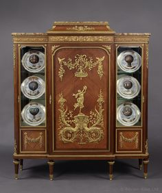 FRANÇOIS LINKE (1855-1946) - A Fine Louis XVI Style Gilt-Bronze Mounted Satinwod Vitrine Cabinet