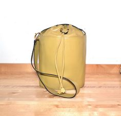 Vintage Salvatore Ferragamo Yellow Leather Bucket by MySunnyStore, $250.00