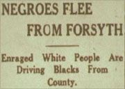 """A historic newspaper headline reading """"Negroes Flee From Forsyth: Enraged White People Are Driving Blacks From County"""""""