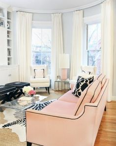 Bachelorette Pad. the windows and curtains. The zebra rug is AMAZING. And im not a big fan of pink but I like this couch...