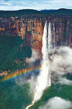 Salto Angel in Venezuela. | Angel Falls is a waterfall in Venezuela. It is the world's highest uninterrupted waterfall, with a height of 979 m and a plunge of 807 m. The waterfall drops over the edge of the Auyantepui mountain in the Canaima National Park.