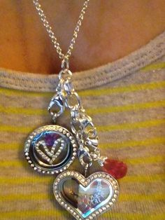 Check out my daughter-in-law's pieces!!!  That's the uniquesness about Origami Owl Jewelry.  She can wear both together, one at atime or just the chain or dangle and much more.   #lockets #personalizedjewelry #mothersdaygift #birthdaygift   cathylvan1.origamiowl.com