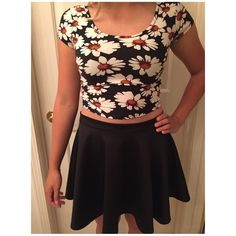 Crop top Black crop top with flowers. New and in perfect condition. Don't know the brand so it's under Brandy for views. Accepting offers:) Brandy Melville Tops